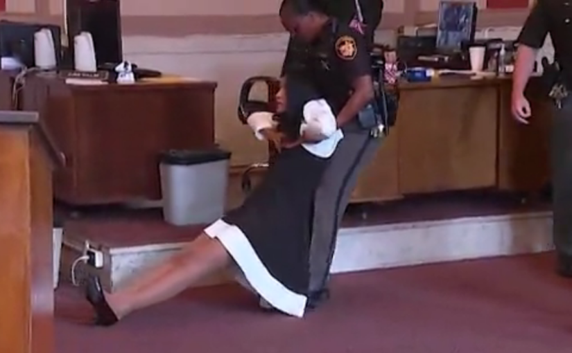 Former judge dragged out of court after beingsentenced
